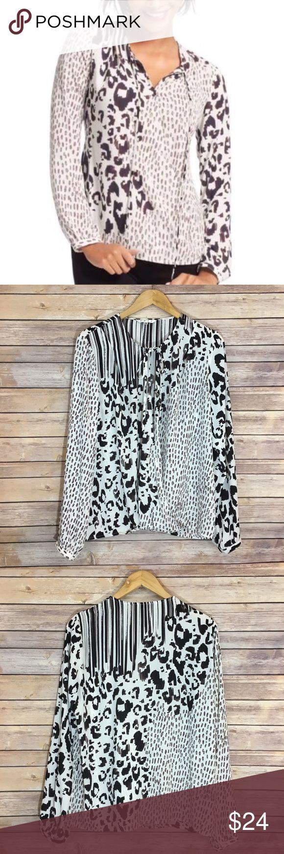 "CAbi Faux Wrap Animal Print Blouse CAbi Faux Wrap Animal Print Blouse. 100% polyester. Pit to pit 23""/  length 26"". Sleeve length 27"" CAbi Tops Blouses"