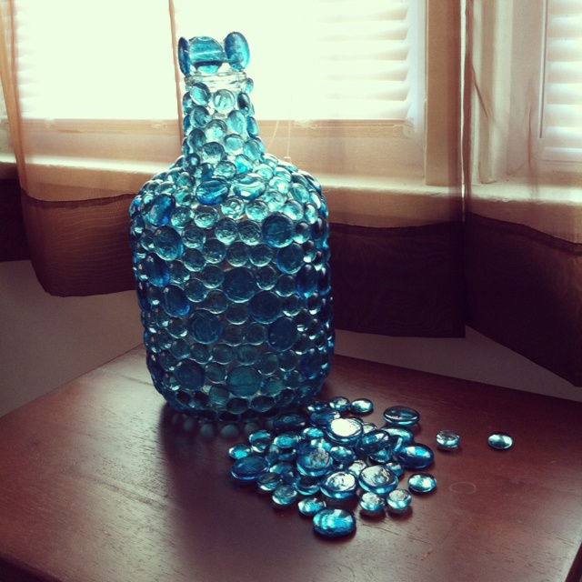 Diy glass beads on wine jug candle holder