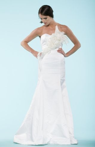 The Meeting Street Gown, one of Carol Hannah Whitfield's Wedding Collection bridal gowns, has a unique sculptural bust detail.