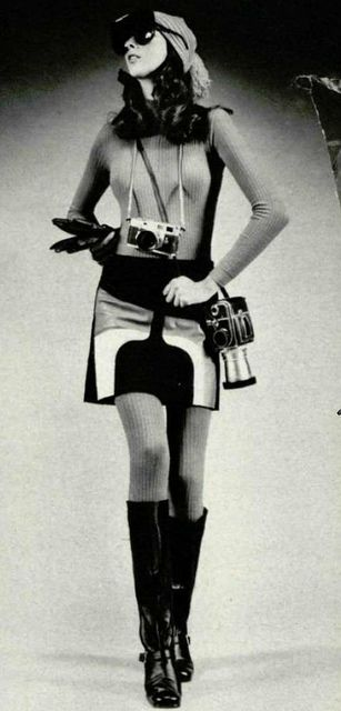1964 - 1974. 1971 Hasselblad and a Leica. The woman in the photograph is wearing gogo boots and mini dress dress with pop pattern.