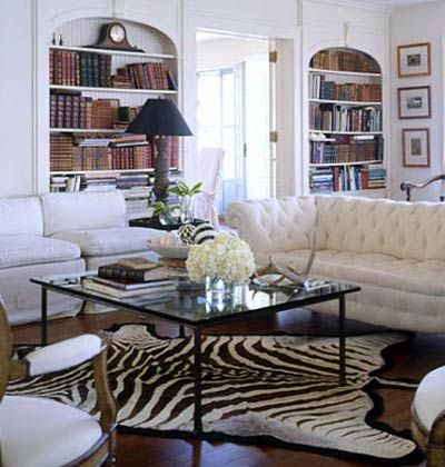 Zebra rug? Check. Understated cream tufted couch? Check. Glass coffee table? The missing puzzle piece.