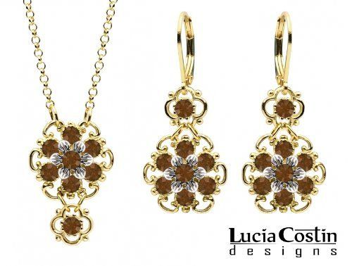 14K Yellow Gold over .925 Sterling Silver Pendant and Earrings Set Designed by Lucia Costin with Brown Swarovski Crystals and Sterling Silver 6 Petal Middle Flowers, Garnished with Dots and Twisted Lines Lucia Costin. $118.00. Produced delicately by hand, made in USA. Unique and feminine, perfect to wear for special occasions and evenings. Lucia Costin jewelry set. Feminine floral design. Adorned with brown Swarovski crystals