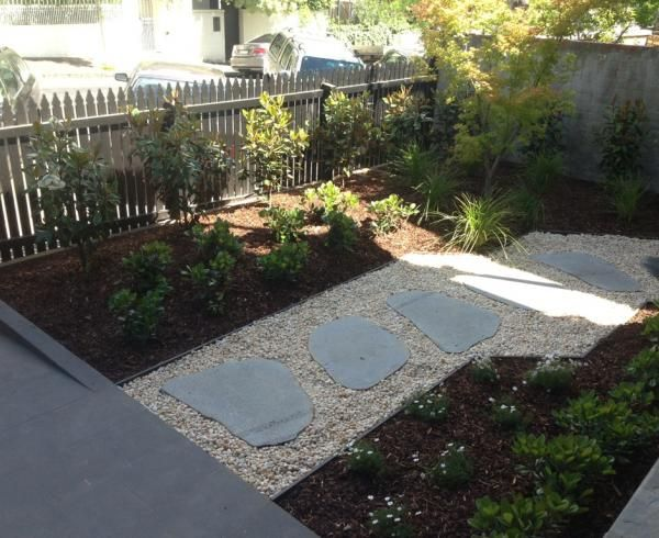 Random bluestone steppers in pathway with new garden beds in Kew.