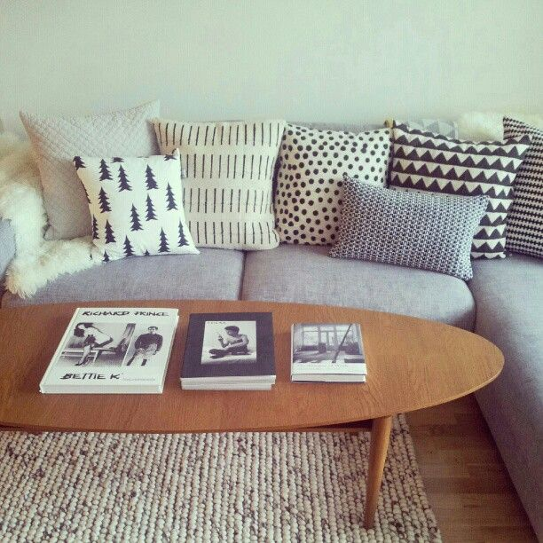Eclectic mix of cushions - varying sizes but common colour theme.