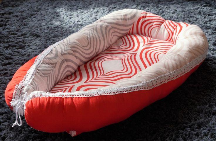 "SOLD ""Crimson Roselle"" Robben Nest baby nest for cosy safe sleeping. Unique handmade design lovingly made in Wellington, New Zealand"