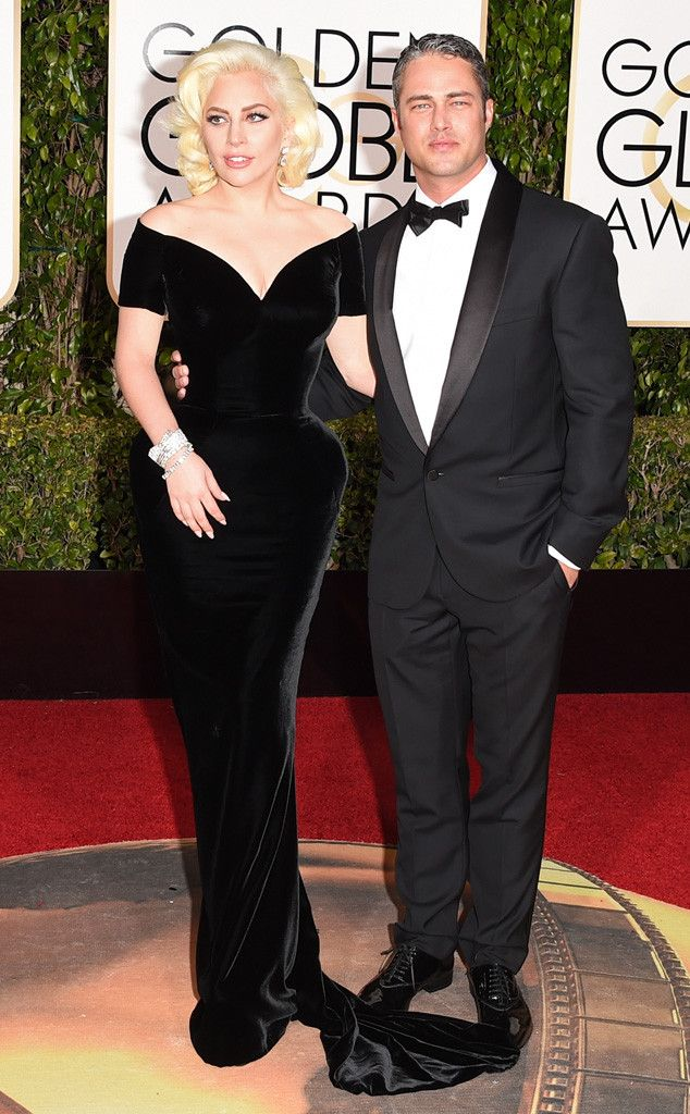 Lady Gaga & Taylor Kinney from Couples at the 2016 Golden Globes The pop star and her super-hot fiancé channel old-school glamour in their designer duds.