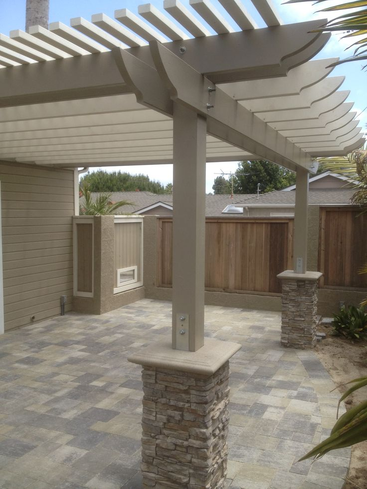 New patio with pergola, we used angelus pavers in this design