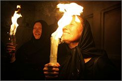 The Orthdox holy fire celebration in Jerusalem dates back at least 1,200 years. The flame's source is a closely guarded secret, but some believe it appears spontaneously from Christ's tomb on the eve of the Orthodox Easter as a message from Jesus that he has not forgotten his followers.