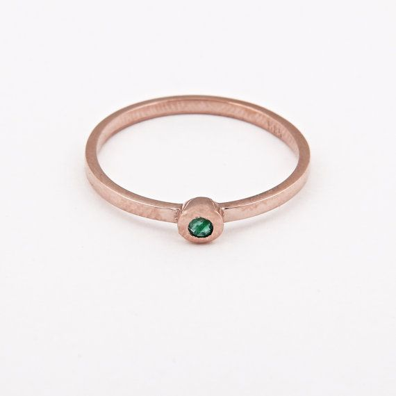 This gorgeous stacking ring is hand-forged in 14k gold, and the natural,mineral emerald is set into our handmade bezel. The delicate ring band  measures 1,6 mm thick, making this ring ideal for stacking.   Emerald gem is the birthstone for all those born in May... if you were this is a particularly lucky stone for you to wear.  ♡A lovely anniversary gift, or perfect for a subtle engagement/wedding ring    We recommend this ring if you plan on wearing this ring every single day for life (ie…