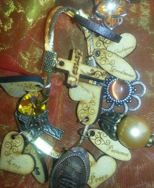 Upcycle old pendants;adding new ones - by Caren. Fruit of the Spirit charms. Laser cut.