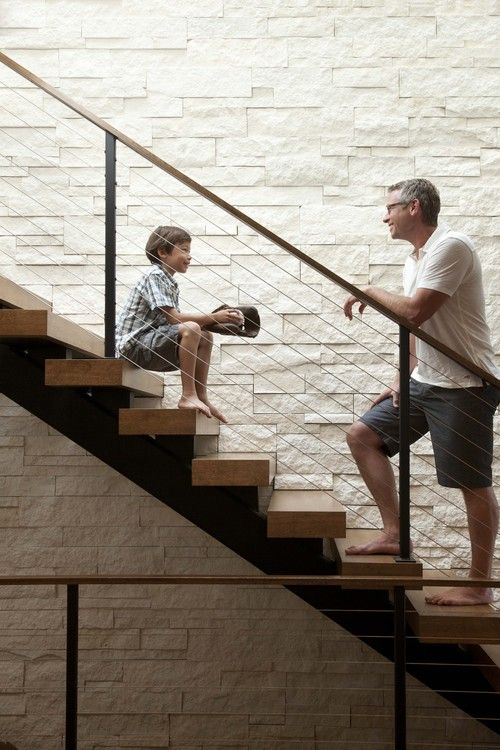 stairs // railing // brick feature wall