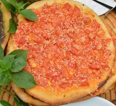 Vegetable Manakeesh /Manakeesh bil khodra   Hadia's Lebanese Cuisine ! A staple breakfast in Lebanon and a classic that is found in every street corner bakery in Beirut - even the smallest village in Lebanon has at least one bakery that sells manakeesh.