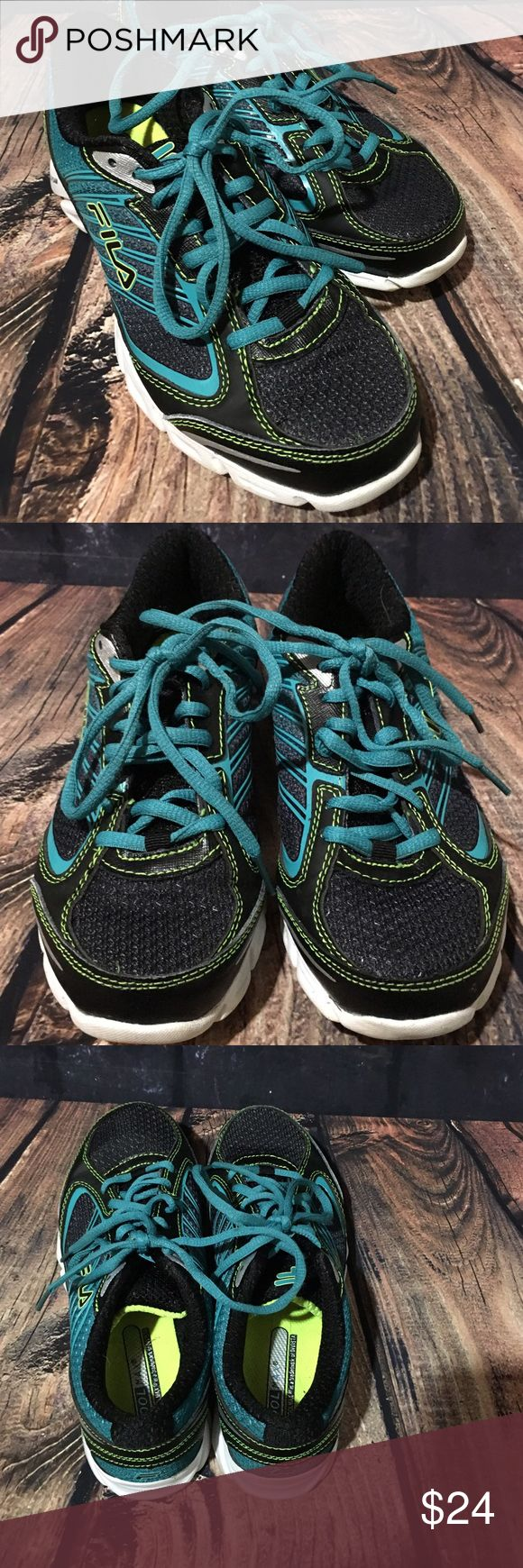 Fila DLS Foam Running Shoes Women's 6.5 Fila athletic running shoes women's size 6.5 DLS Foam, black and teal gently used, minimal wear. Measurements are approximate 10 1/2 inches on outer sole 9 1/4 inches on inside sole Fila Shoes Athletic Shoes