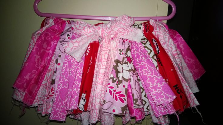 Fluffy diy rag skirt/tutu. All you need is some fat quarters(I think I used six), elastic or ribbon and scissors to cut. I checked out several tutorials...they all used a loop method to tie the fabric to the elastic or ribbon. Easy no sew project :)