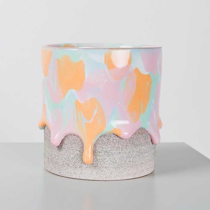 Ceramic artist Brian Giniewski produces delightful earthenware vessels that appear to be oozing thick, colorful drips that are frozen in time. The Philadelphia-based ceramicist achieves the texture of the vases and bowls by applying a gritty, matte slip to each piece which contrasts nicely with a sp