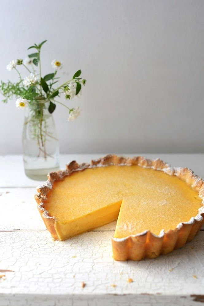Summer Lemon Tart RecipePastry; 200g butter, out of the fridge for 20 minutes, just a bit soft, chopped into 3cm cubes 1/2 cup icing sugar 1 3/4 cups plain flour the finely grated zest of 1 medium lemon 1 egg yolk (keep egg white) Filling: 7 eggs 3 egg yolks 1 1/2 cups caster sugar 350ml cream 400ml freshly squeezed lemon juice