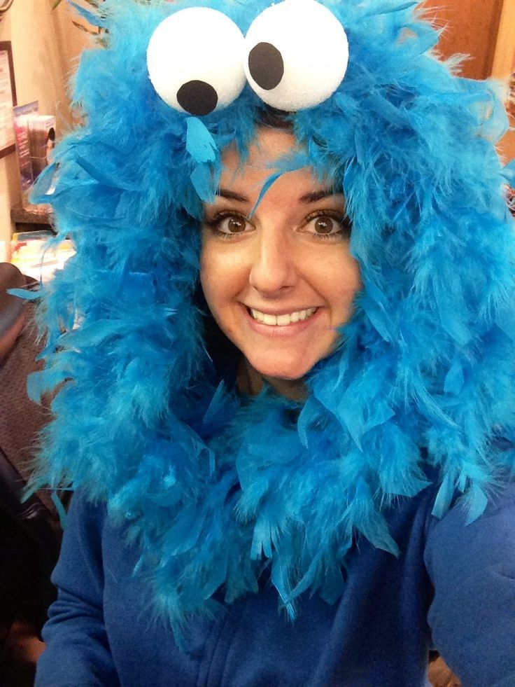Cookie Monster Head sweatshirt added colored feather boa  eyes out of styrofoam balls.   cut a flat side to Styrofoam balls so you can glue them evenly to the top of the hoodies.