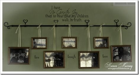 Curtain rod with pictures hung by ribbon ... instead of making a bunch of holes
