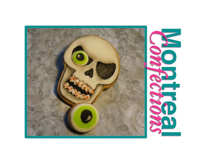 how to decorate a skull halloween cookie video via thecookiecuttercompany