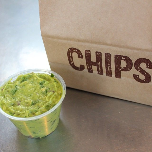 Snapping a photo of your #chipsandguac before taking a bite. Now that's patience.