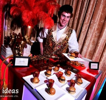 Such a great idea! #Mini #burger and #fries served by a #lion tamer! #circus #events #bigtop #eventfood #actor #decor #eventdecor #brightideas