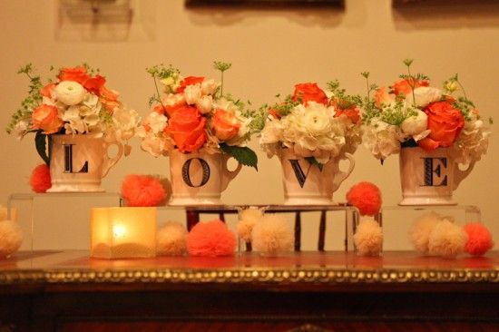 Coral Wedding Flowers in mugs- repurpose bouquets into decoration on favor table? Or on cake table?