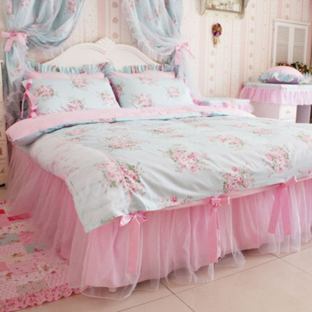 I really love this look. I like the bedcover, the tullle bedskirt, and the floral patchwork rug best.