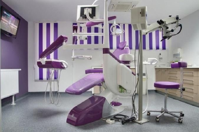 Okay so yes we have a slight obsession with purple in this image...purple dentist chair, purple dental office blinds and a purple dental wall. This works great if you are on the hunt for new Paediatric office decor or more grown up adult dental decor.