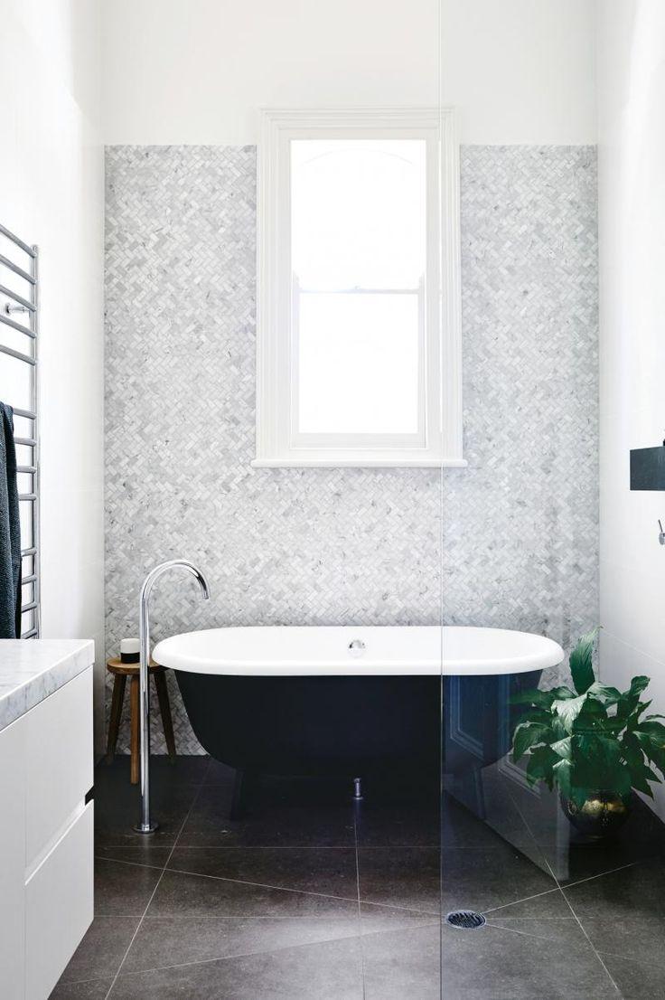 Black, white and Carrara marble + herringbone tiles. Bathroom. Inside out magazine 2017. Designed by Austin Design Associates. Built by Pop Building Group Photographer: Derek Swalwell Stylist: Rachel Vigor