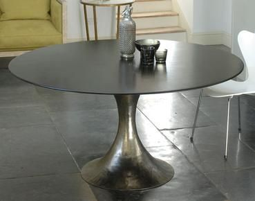 Love this Saarinen inspired - metal tulip table. Too bad it costs more than my car is worth :)