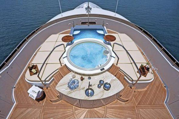 The jacuzzi and the surrounding teak decking looks very inviting.