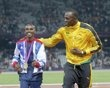 Jamaica's Usain Bolt (R) celebrates with Britain's Mo Farah after each received a gold medal, Bolt for men's 4x100m relay and Farah for men's 5000m at the victory ceremony at the London 2012 Olympic Games at the Olympic Stadium August 11, 2012.