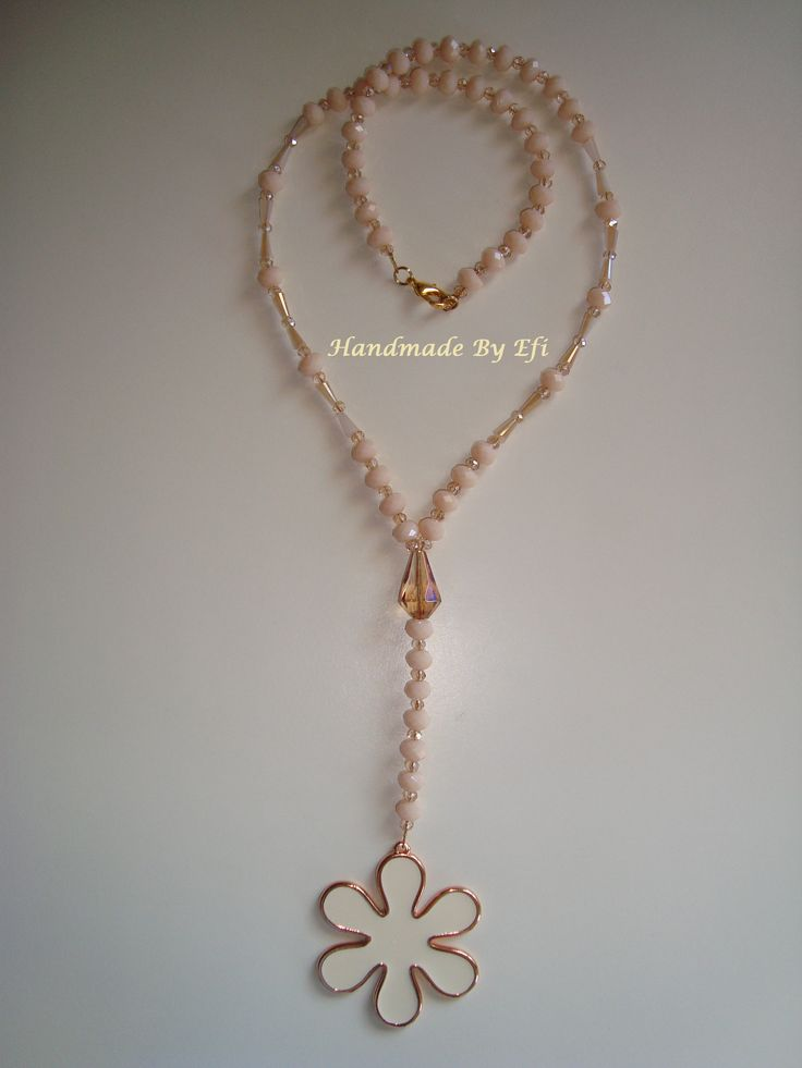 https://www.facebook.com/pages/Handmade-Creations-by-Efi/187659788043676  long necklace , rosary type with daisy