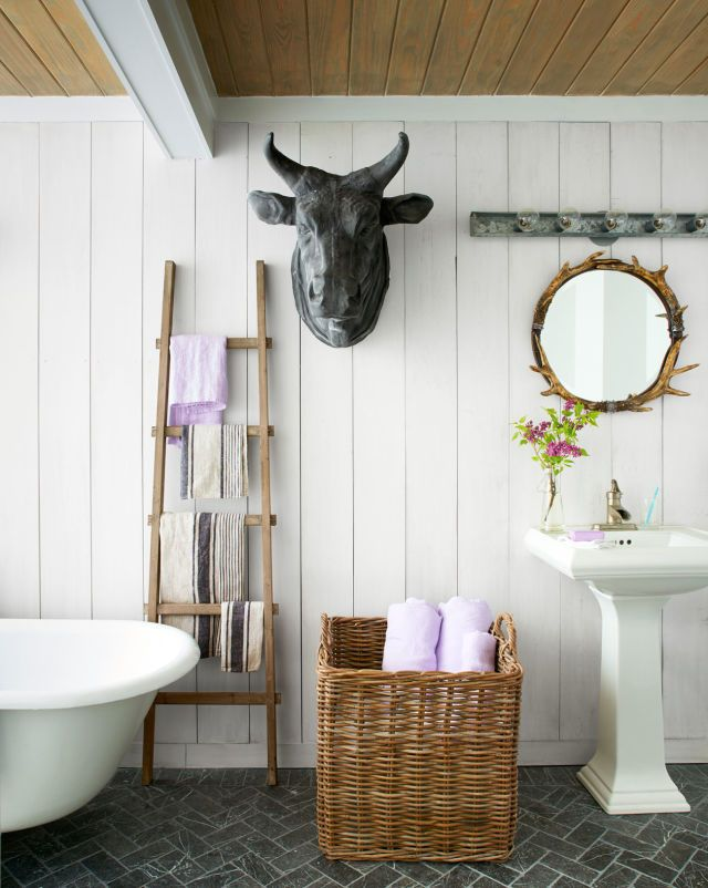 This farmhouse style bathroom features shiplap and