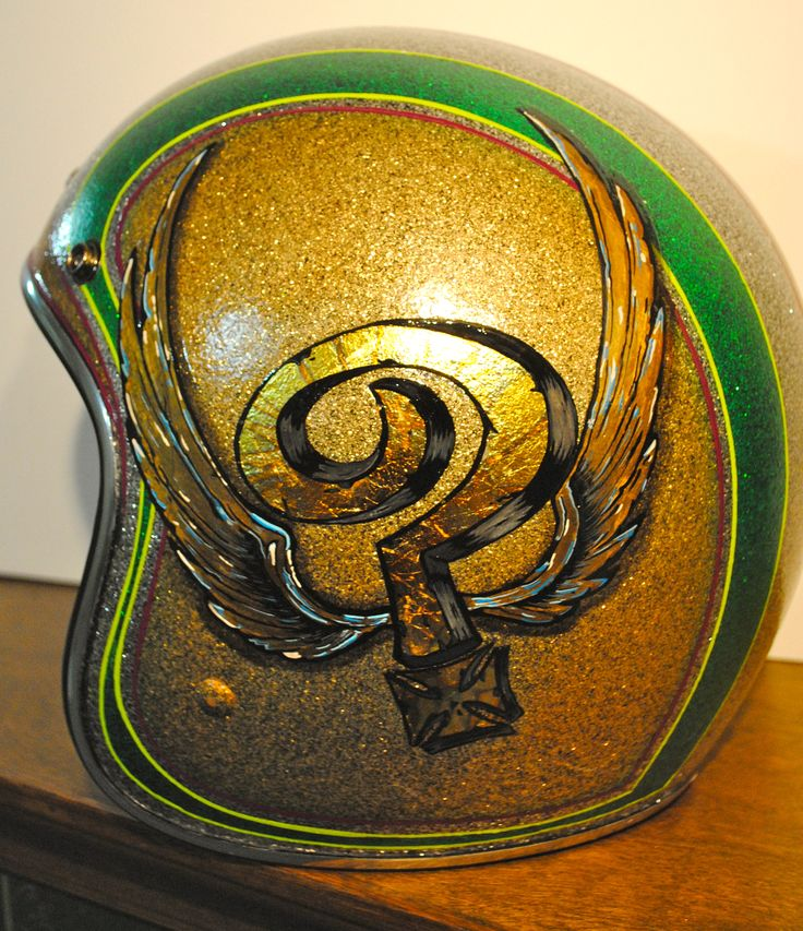 Rob Valentini Valentini Pinstriping Indian Larry Tribute on my helmet. I did the candy colors and metal flake as well.