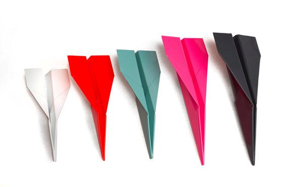 """Powder-coated metal """"paper airplanes"""" by artist Tony Greer and Marfa-based @Christy Ast & Crew."""
