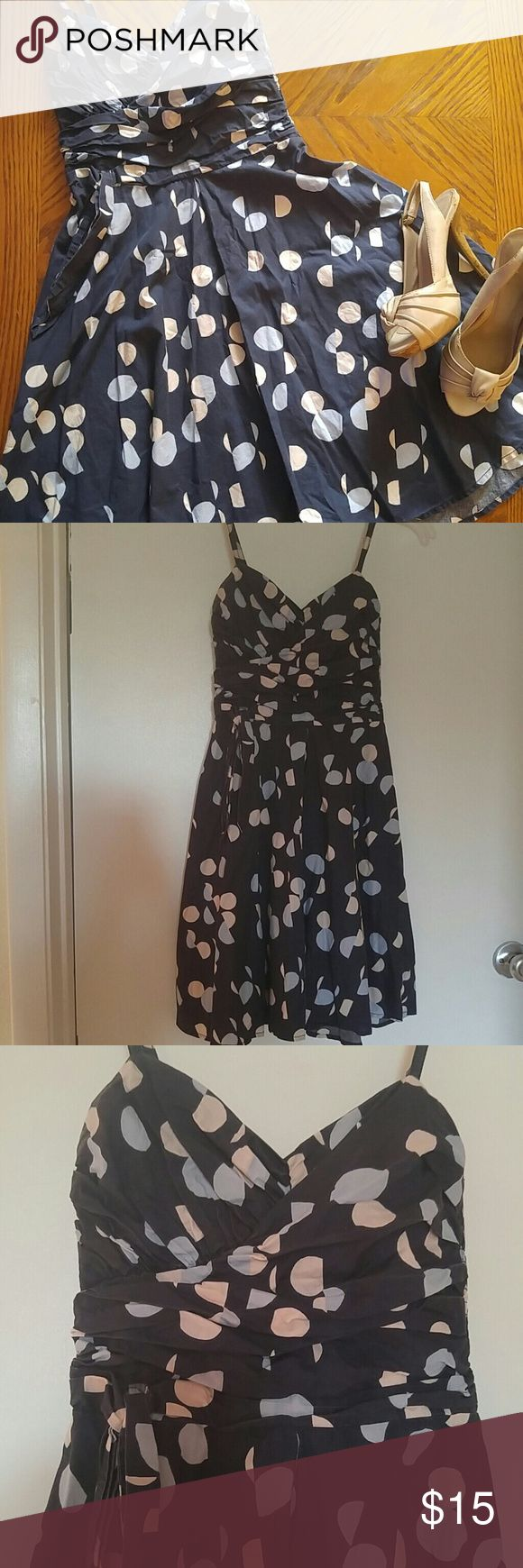 Flirty polka dot dress Spaghetti strap dress with fitted and wrapped chest and torso with a wide skirt. A very flattering style! Great dress for nights out and dancing! Looks great with heels or even keds! Would fit XS-S H&M Dresses