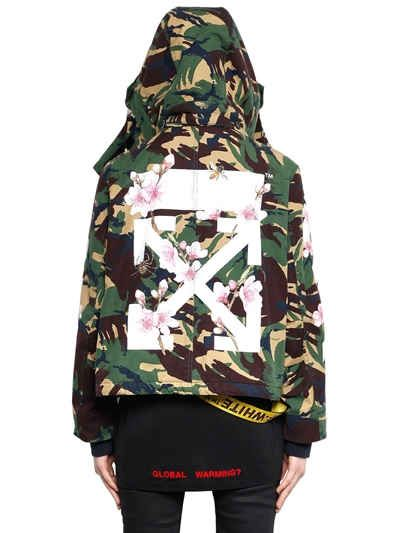 OFF WHITE - M65 CAMO & CHERRY BLOSSOM CANVAS JACKET - JACKETS - GREEN - LUISAVIAROMA - Detachable hood with buttons. Concealed front snap button and zip closure. Ribbed cuffs . Drawstring at hem . Placed print on sleeves and back panel . All over camouflage print placement may vary . Two side button flap pockets. Satin lining. Sample size: 40