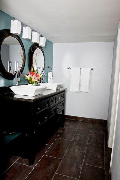 Dark floor dark cabinetry blue wall Elle Decor Bathroom Contemporary room by DTN Design