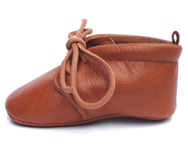 Lapito – Nutmeg is a part of Lapito Footwear's 2014 range and has been a popular choice for both girls and boys. The upper is made of a soft brown leather with tan laces and lining for a subtle contrast • Available at thebigdesignmarket.com