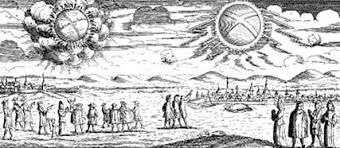 Two enormous, glowing wheels are seen in the sky over Mecklenburg and Hamburg, Germany, on Nov. 4, 1697