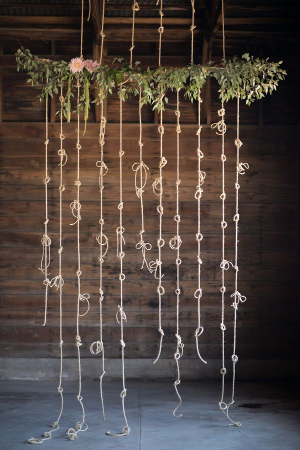 """tying the knot"" rope wedding backdrop."