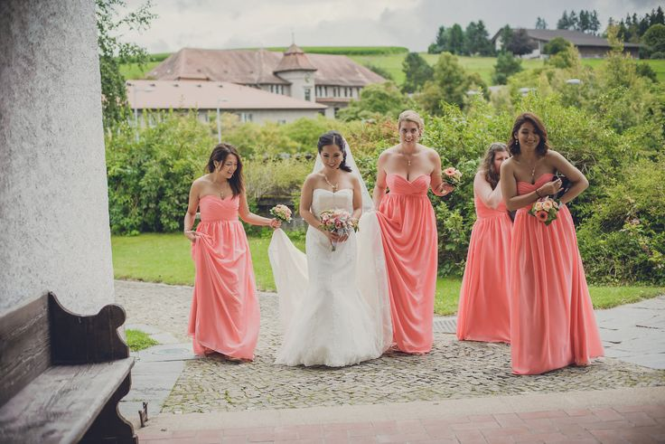 Bridesmaids in peach dresses from JJs house escorting the bride to the church. Photo by Monica Tarocco
