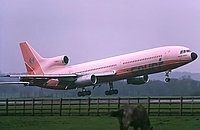 Court Line, Lockheed L-1011-385-1 TriStar 1, London - Gatwick (LGW / EGKK), UK - England, April 1974, The donkey seems little bothered by the pink monster rushing past.