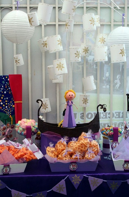 """I love the Rapunzel in the boat centerpiece with the lanterns """"floating"""" all around above her! (Rapunzel by Mesa de Dulce, via Flickr)"""
