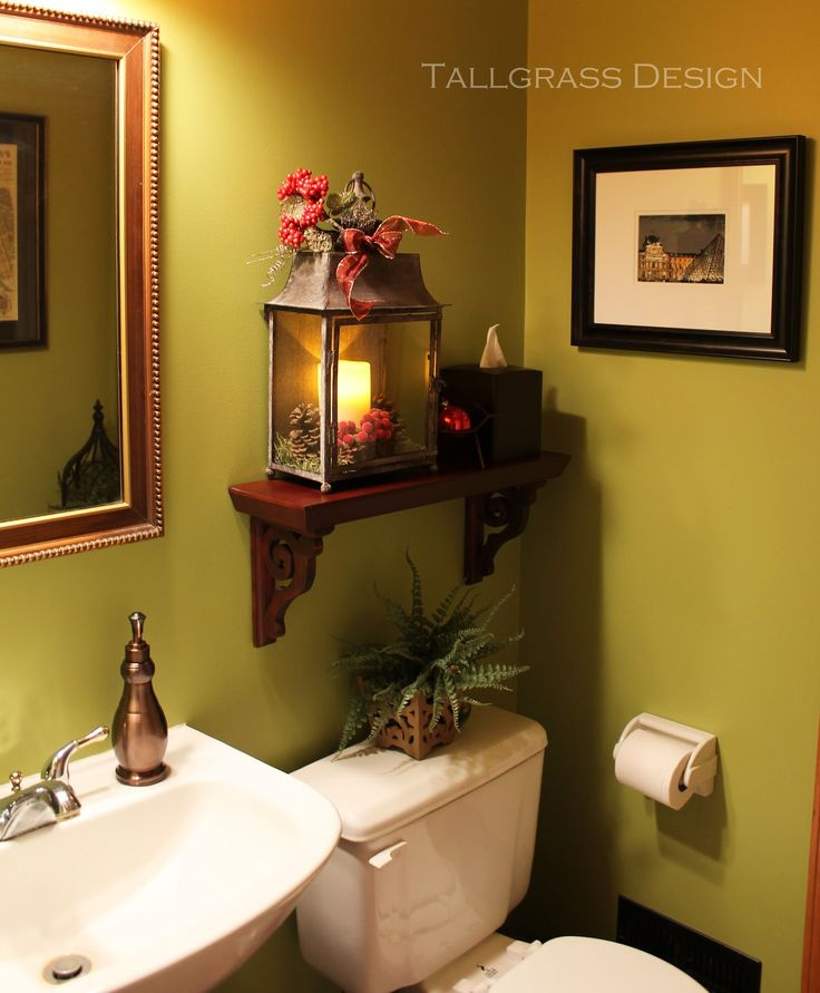 Love the color Love this decor. Never would have thought about putting a lantern in the bathroom!!