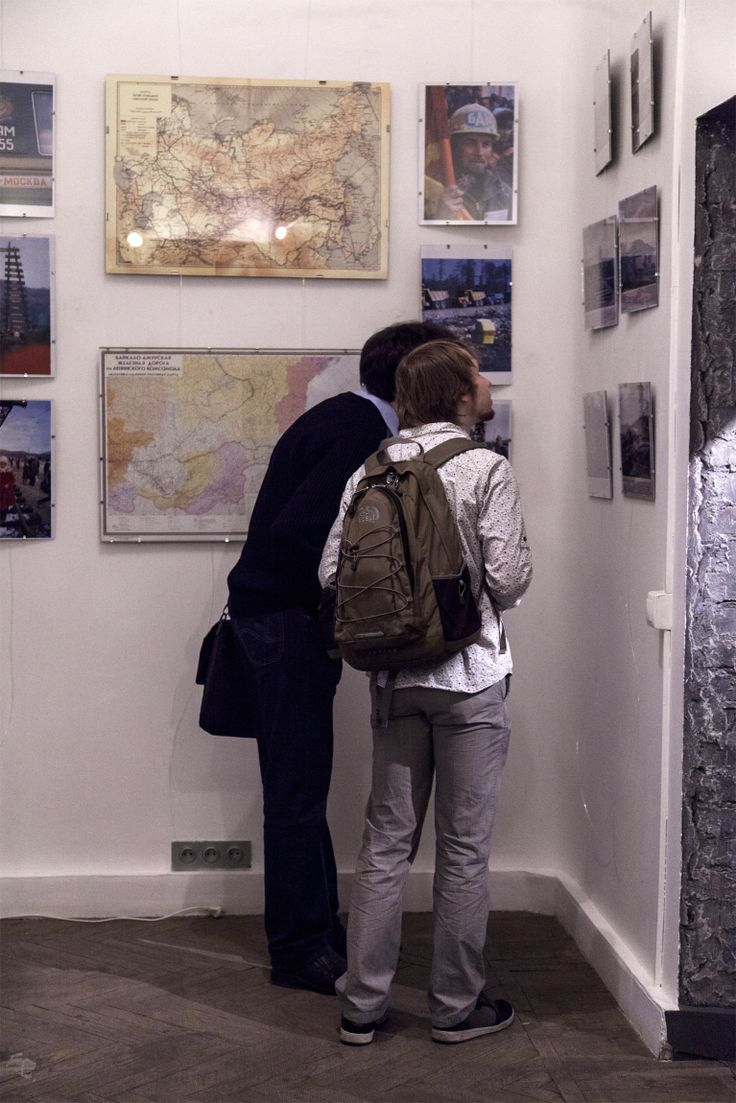 """I am watching at the artwoks and photos by other participants at the exhibition """"Main line"""" (it is about Trans-Siberian road)."""