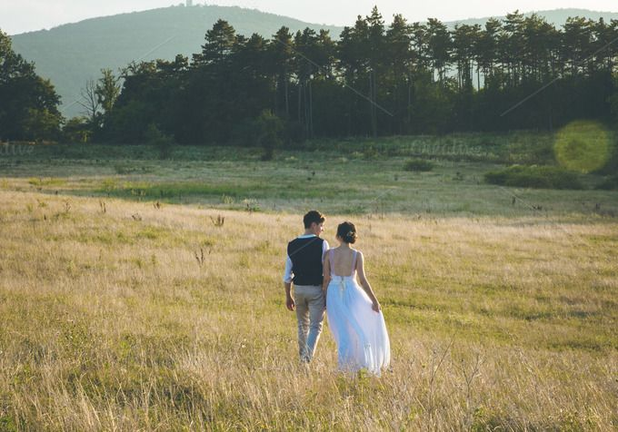 Couple walks on the meadow by Farkas B. Szabina on Creative Market