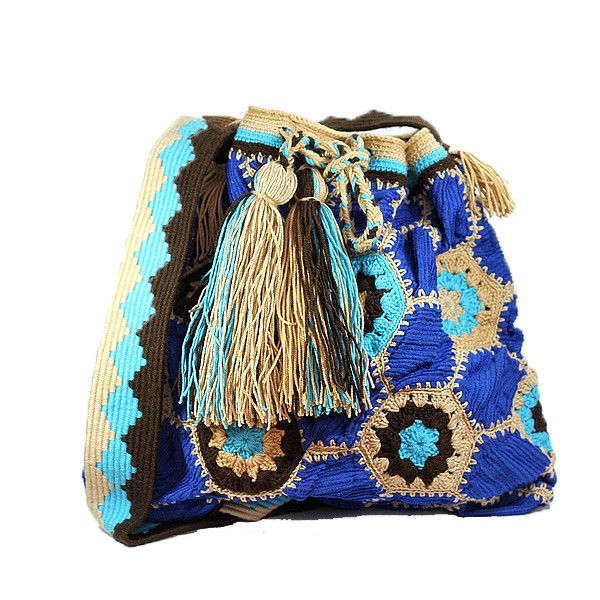 """This #ColombianStyle #handmade #mochila is called """"Hexagonal Velveteen"""". One single woman sews it and it takes approximately 25 days to make. The bag has a hexagonal velveteen design with dark blue, light blue, brown, bone thread colors.  #Colombian #Style offers you #vibrant colors and beautiful patterns that represent the #universe and nature. This #bags is a #unique piece of #art."""