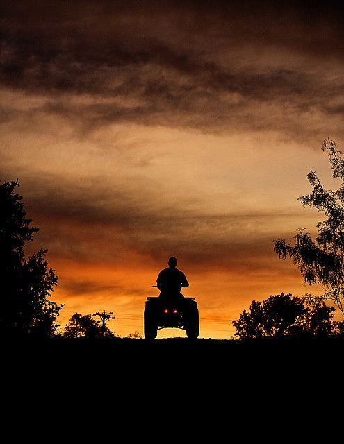 Sometimes a girl has to use what she's got. ATV riding